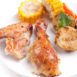 Roasted chicken wings and legs with roasted potatoes and corn — Stock Photo