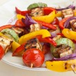 Plate with halloumi and vegetables kebabs — Stock Photo