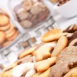 Big pile of various cookies with three cookie jars at the back — Zdjęcie stockowe