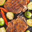 Stock Photo: Grilled pork chops with vegetables