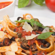 Stock Photo: Linguine pastwith fresh tomato puttanescsauce
