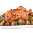 Roasted chicken with roasted potatoes and parsley — Stock Photo #41988571