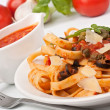 Stock Photo: Linguine pastwith fresh tomato puttanescsauce, cheese and ba