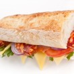 Постер, плакат: Long whole wheat vegetarian baguette sandwich