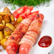 Sausages wrapped in bacon — Stock Photo #41989899
