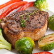 Grilled pork chops with vegetables — Stock Photo #41989935