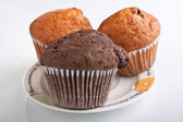 Three muffins on a plate — Stock Photo