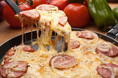 Sausage and onion pizza — Stock Photo