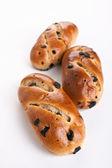 Three buns with raisins — Stock Photo