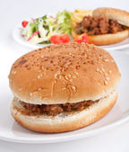 Two minced meat burgers and salad — Stock Photo