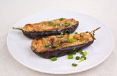 Two stuffed with cheese and mushrooms eggplants — Stock Photo
