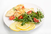 White fish with vegetables and lemon — Stock Photo
