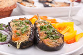 Cheese and mushrooms aubergines on a plate — Stock Photo