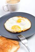 Fried eggs, coffee and toast — Stock Photo