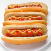 Three classic hotdogs — Stock Photo