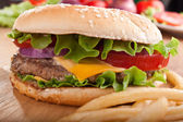 Cheeseburger and french fries with ingredients — Stock Photo