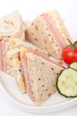 Club sandwiches with ham and cheese on a plate close-up — Stock Photo