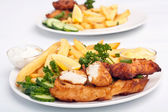 Two servings of fish and chips — Stock Photo