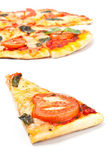 Pizza margharita slice with pizza at the back — Stock Photo