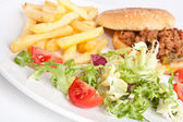 Minced meat burger with french fries and salad — Stock Photo