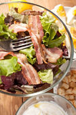 Caesar salad with bacon and eggs — Stock Photo
