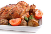 Whole golden roasted chicken — Stock Photo