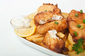 Fish and chips on a plate on white background — Stock Photo