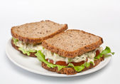 Egg salad sandwiches on brown toasted bread — Stock Photo