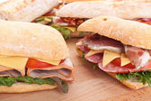 Group of stuffed sub sandwiches on a table — Stock Photo