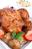 Roasted chicken with roasted potatoes — Stock Photo
