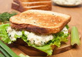 Egg salad sandwich on brown toasted bread and ingredients — Stock Photo