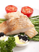 Tilapia fish with asparagus — Stock Photo