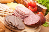 Meat, bread and vegetables — Stock Photo