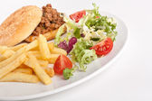 Minced meat burger with french fries and salad — Stockfoto