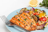 Trout with roast vegetables and couscous — Stock Photo
