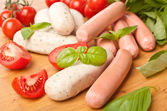 Pile of raw sausages — Stock Photo