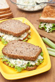 Egg salad sandwiches on brown toasted bread and ingredients — Stock Photo