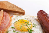 Fried egg, toast, sausage and bacon — Stock Photo