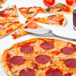 A close up of a whole salami pizza, sliced margherita pizza — Stock Photo #42002379