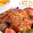 Whole golden roasted chicken with roasted potatoes, fresh tomato — Stock Photo #42004135