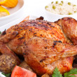 Whole golden roasted chicken with roasted potatoes, fresh tomato — Stock Photo