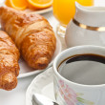 Постер, плакат: Breakfast with coffee and croissants