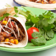 Stock Photo: Burrito and cilantro on plate