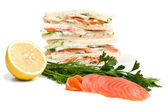 Stack of club  sandwiches with salmon and cucumbers — Stock Photo
