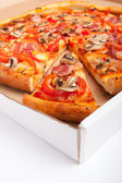 Ham and mushroom pizza in a pizza-box — Stock Photo