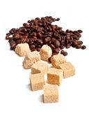 Coffee-beans and brown sugar cubes — Stock Photo