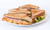 Meat, lettuce and cheese sandwiches on toasted bread — Stock Photo