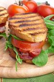 Bacon, lettuce and tomato BLT sandwich with fresh ingredients at — Stok fotoğraf
