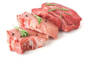 Raw pork chops and beef medallions — Stock Photo