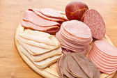 Big group of thinly sliced meat on  a cutting board — Stock Photo